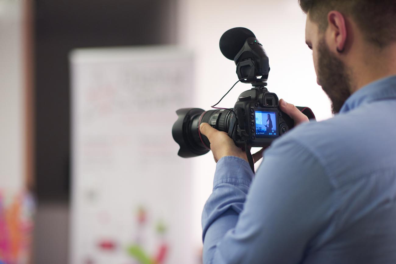 videographer recording on conference